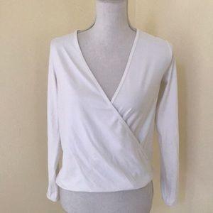 Lululemon size 2, white faux wrap L/S high low top